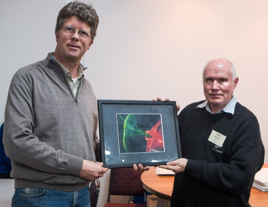 Phit Dyer, President of the Wellington Photography Society, presenting the Stella Daniel print to Paul Whitham, President of the Hutt Camera Club (on behalf of Ian Watkins)