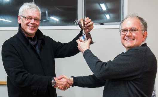 Tony Bridge presents the Wellington Interclub Print Battle Trophy to Mark Berger, President of the Karori Camera Club.